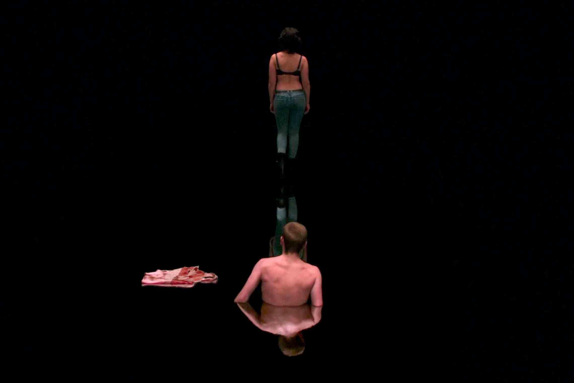 Scarlet Johanson's character walking across her black goo body in Under The Skin (2014)